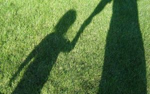 shadow holding hands