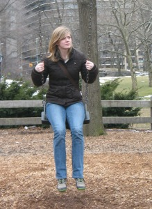depressed lonely young woman on swing