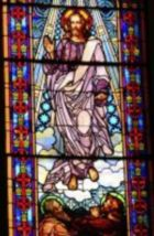 stained glass Christ ascending