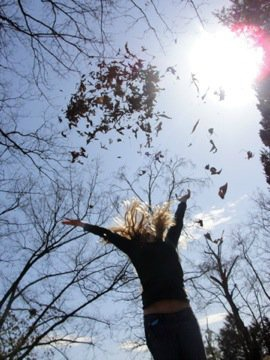 Stages of Bereavement -Hope- throwing leaves in the air